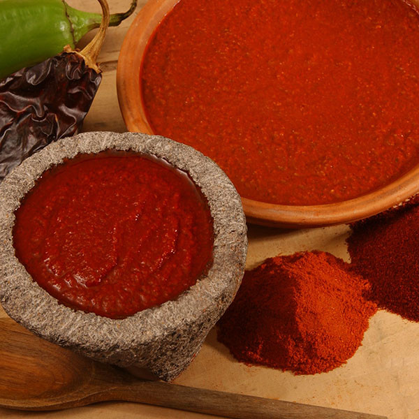 Red-Chile-Puree-in-Bowls Bueno Foods  %name